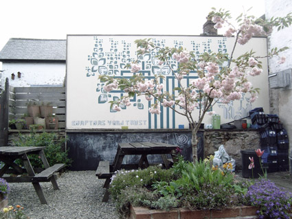 Compton's Yard Charitable Trust's Garden in Llanidloes, with mural by Kleo Morrison